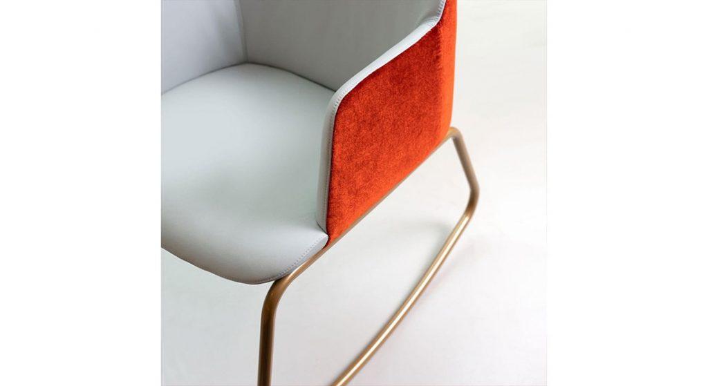 Deep modern rocking chair with gold frame