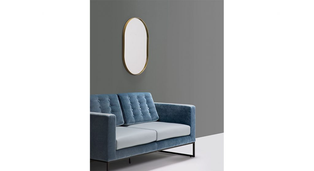 oval mirrors with gold edge band with velvet sofa
